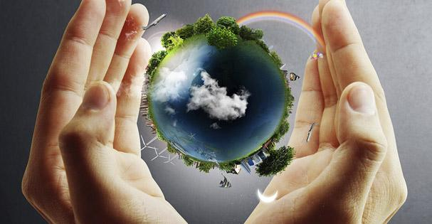 decorative photo of world in pair of hands with rainbow